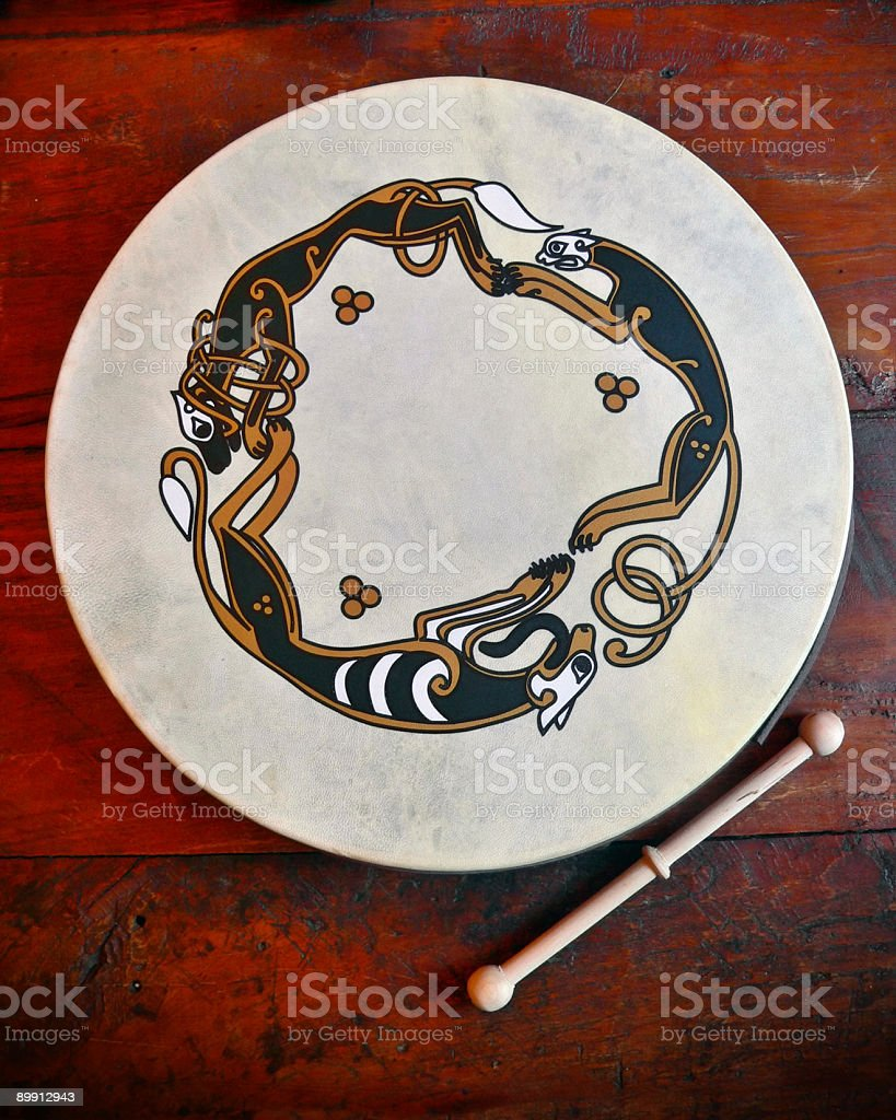 Traditional Irish Scene with Bodhran Drum on wooden bar counter stock photo