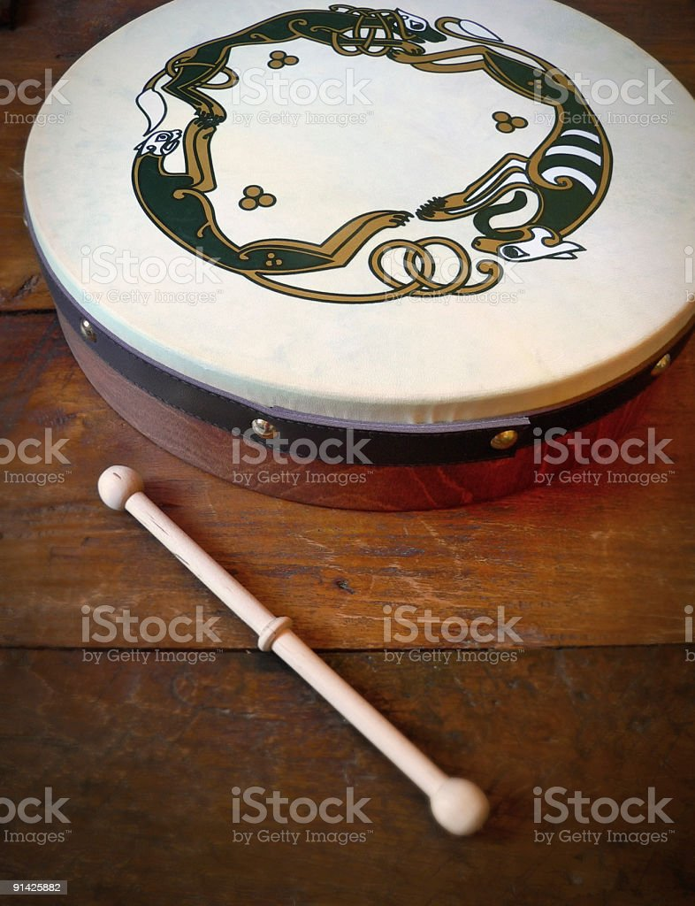 Traditional Irish Scene with Bodhran Drum on wooden bar counter royalty-free stock photo