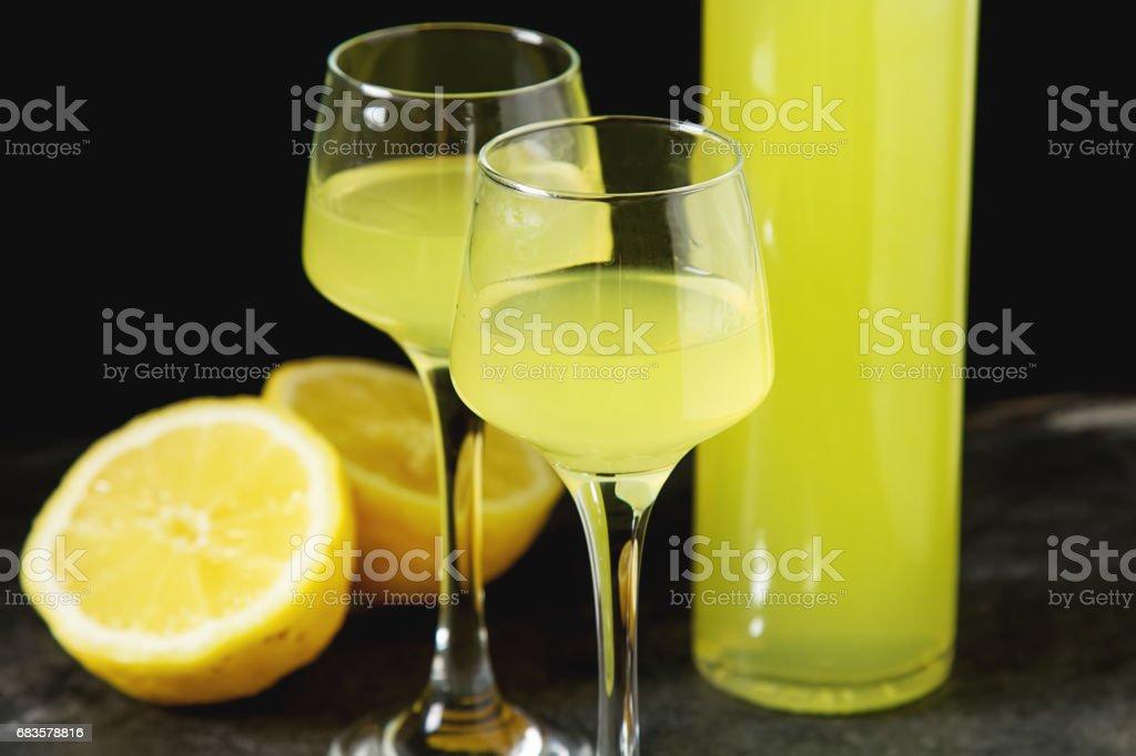 Traditional Italian acoustical leker. Lemonchello of lemons. Dark background. stock photo