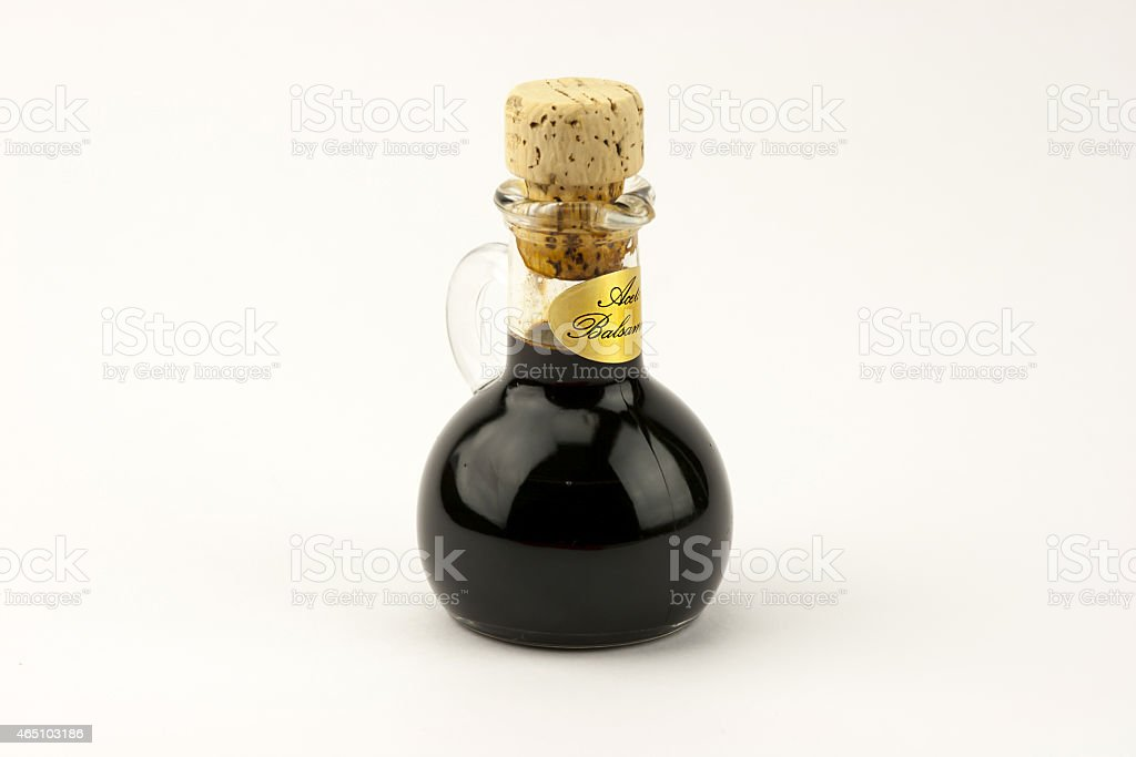 Traditional italian balsamic vinegar isolated on white backgroun stock photo