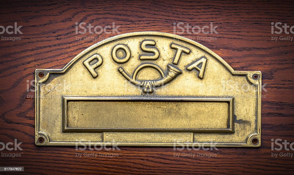 Traditional Italian brass postbox stock photo