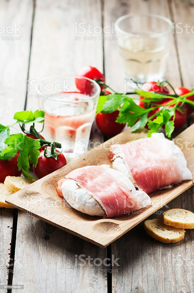 Traditional italian cheese tomino with bacon stock photo