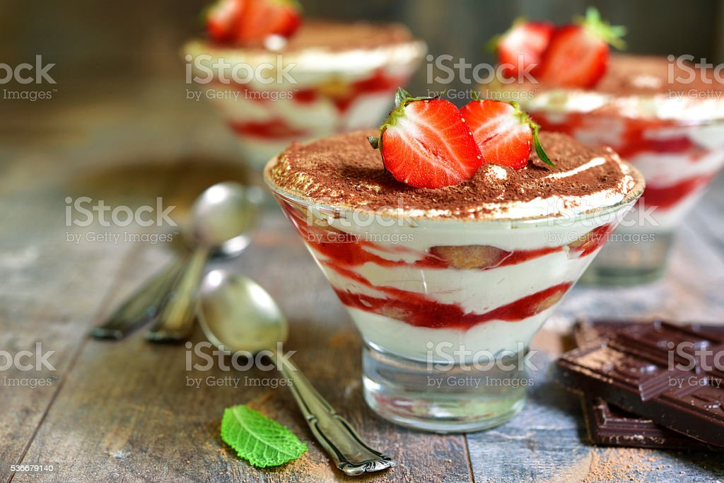 Traditional italian dessert tiramisu with strawberry. stock photo