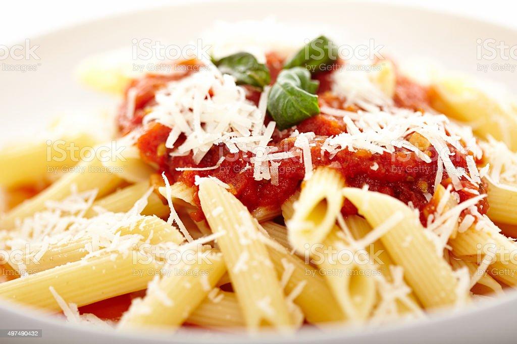Traditional italian pasta with tomato and pepperoni sauce decora stock photo