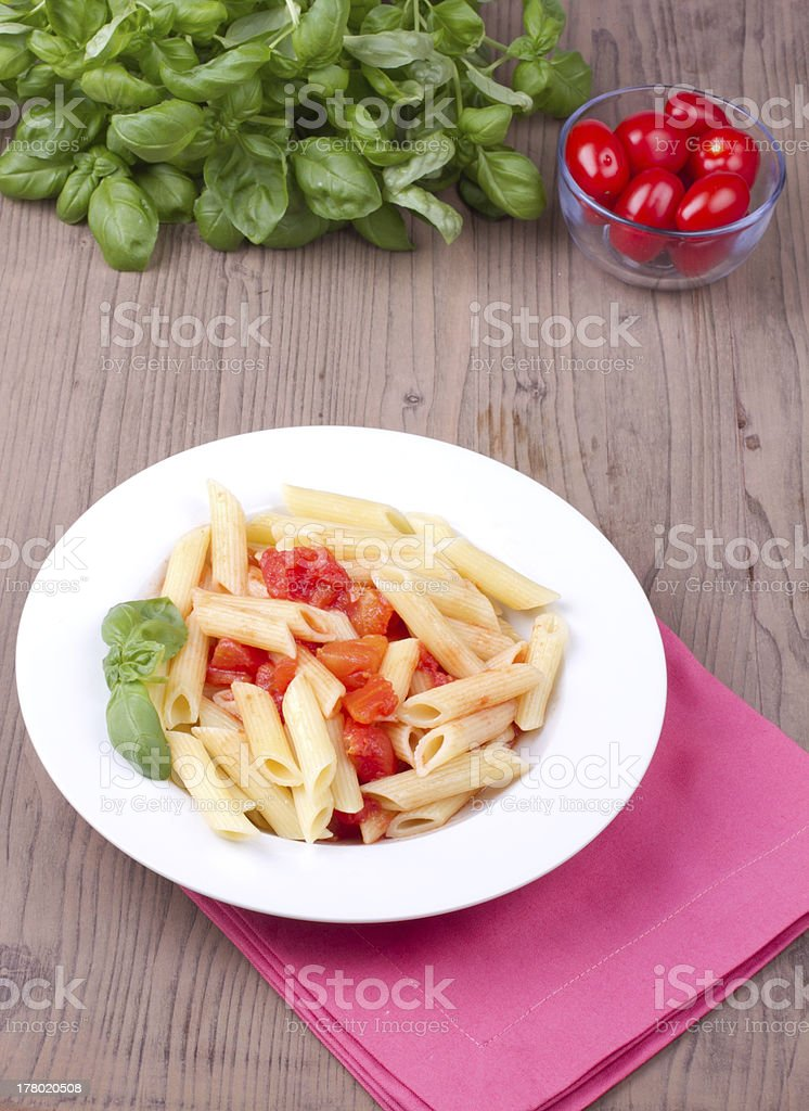 Traditional italian pasta with tomatoes royalty-free stock photo