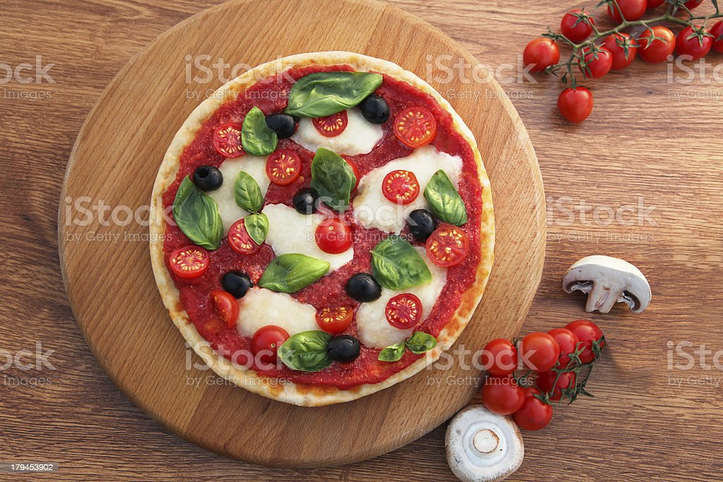Traditional Italian pizza with tricolor royalty-free stock photo
