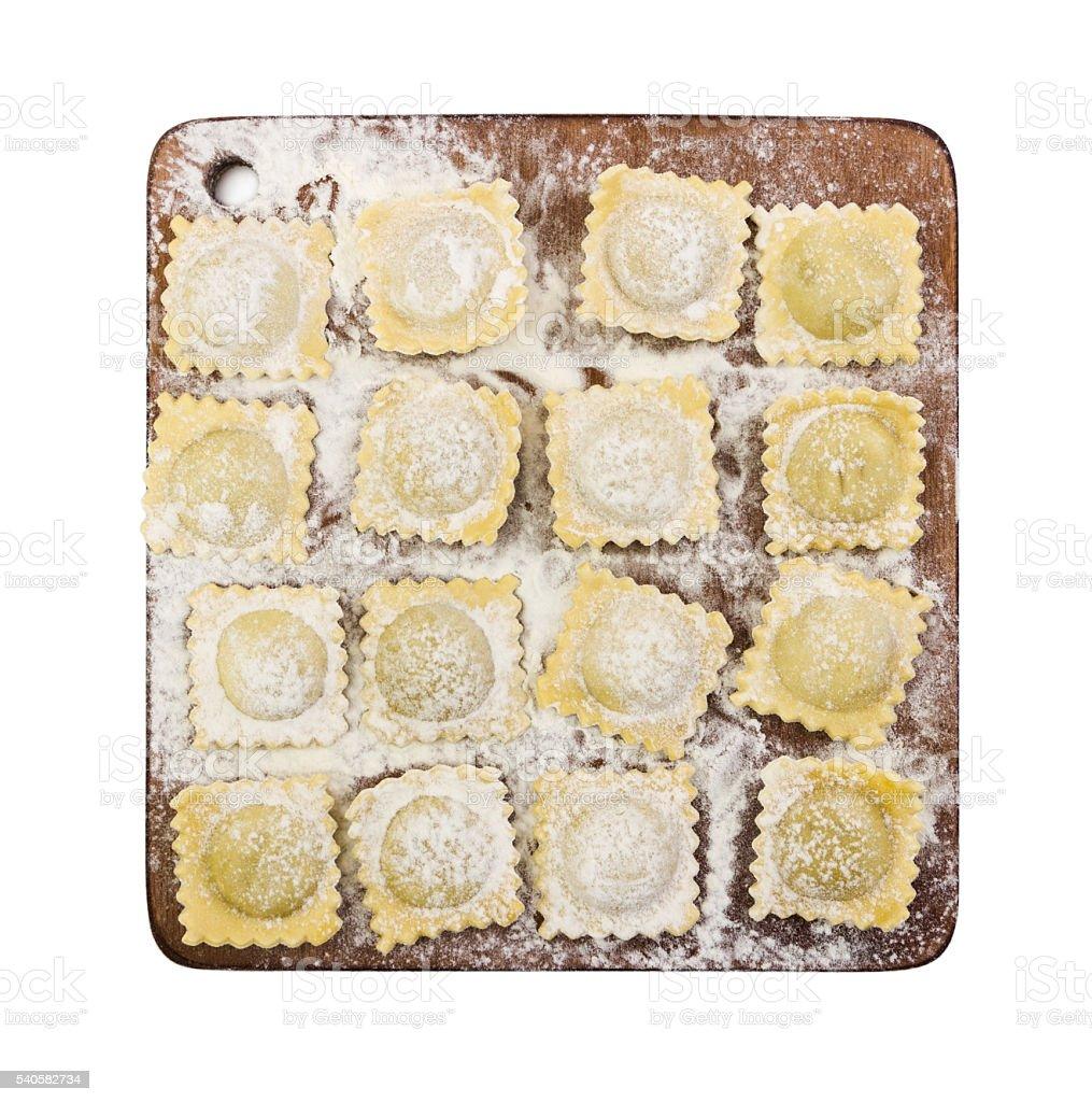 Traditional italian ravioli on cutting board stock photo