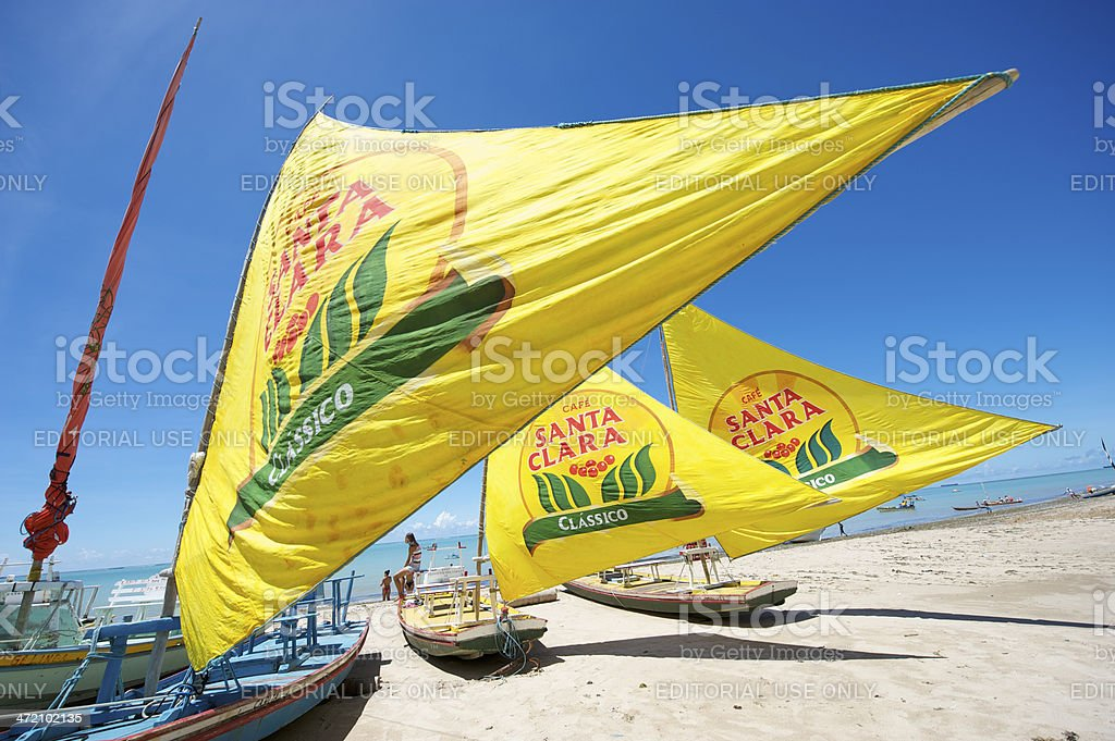 Traditional Jangada Sailboats with Yellow Sails in Maceio Brazil stock photo