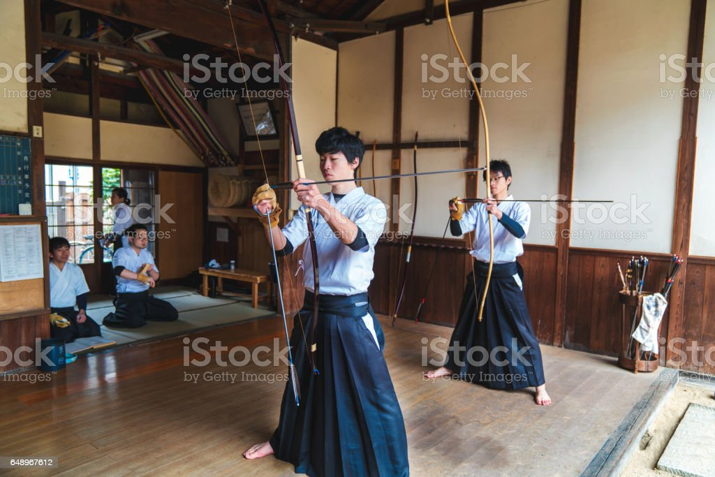 Traditional Japanese archers ready their bows stock photo