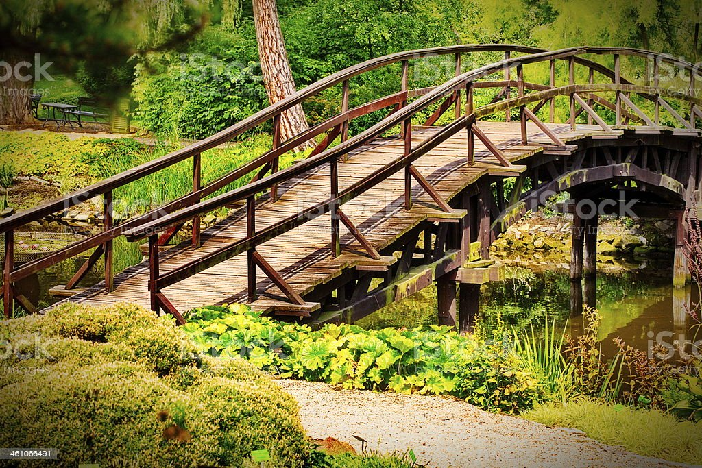 Traditional Japanese bridge in green garden stock photo