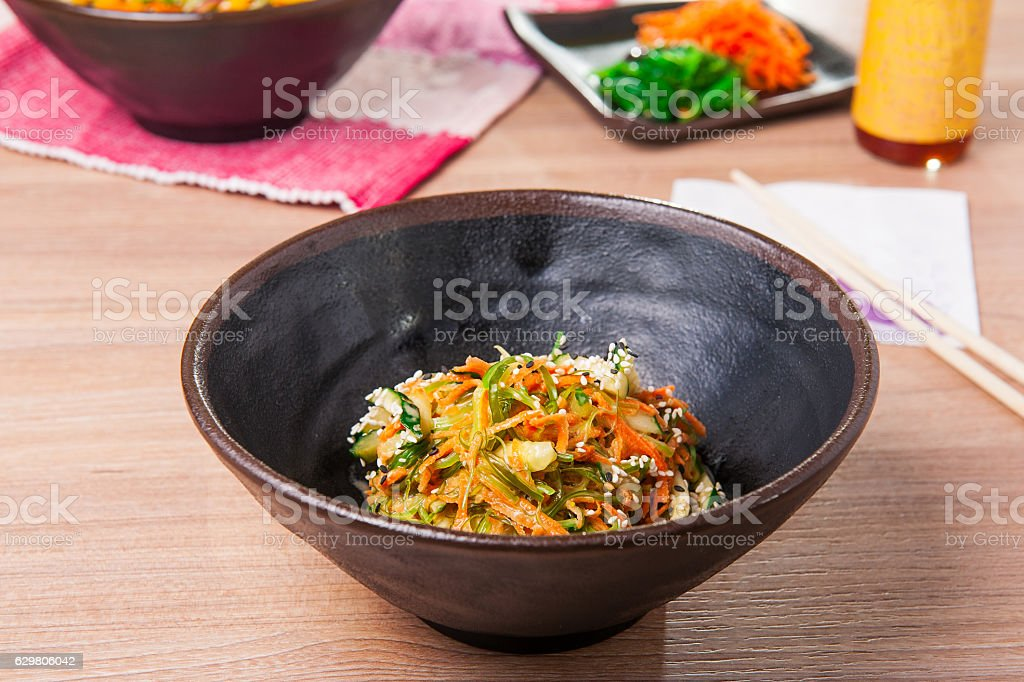 Traditional Japanese Chuka Wakame seaweed salad with sliced carrot, cucumber stock photo