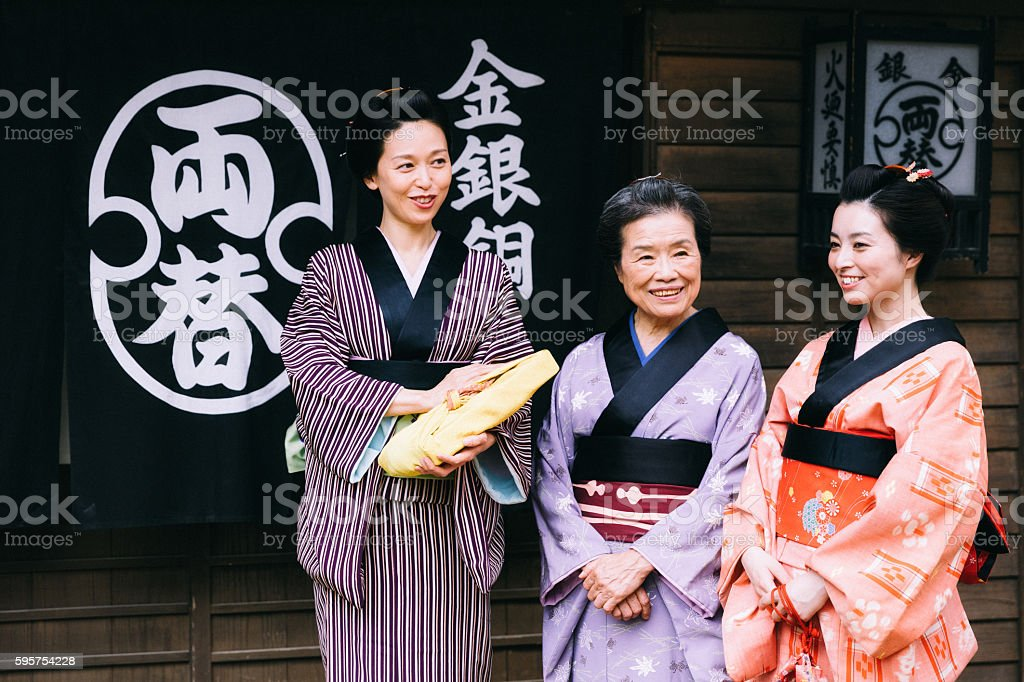 Traditional Japanese geisha and maiko woman in japanese village stock photo