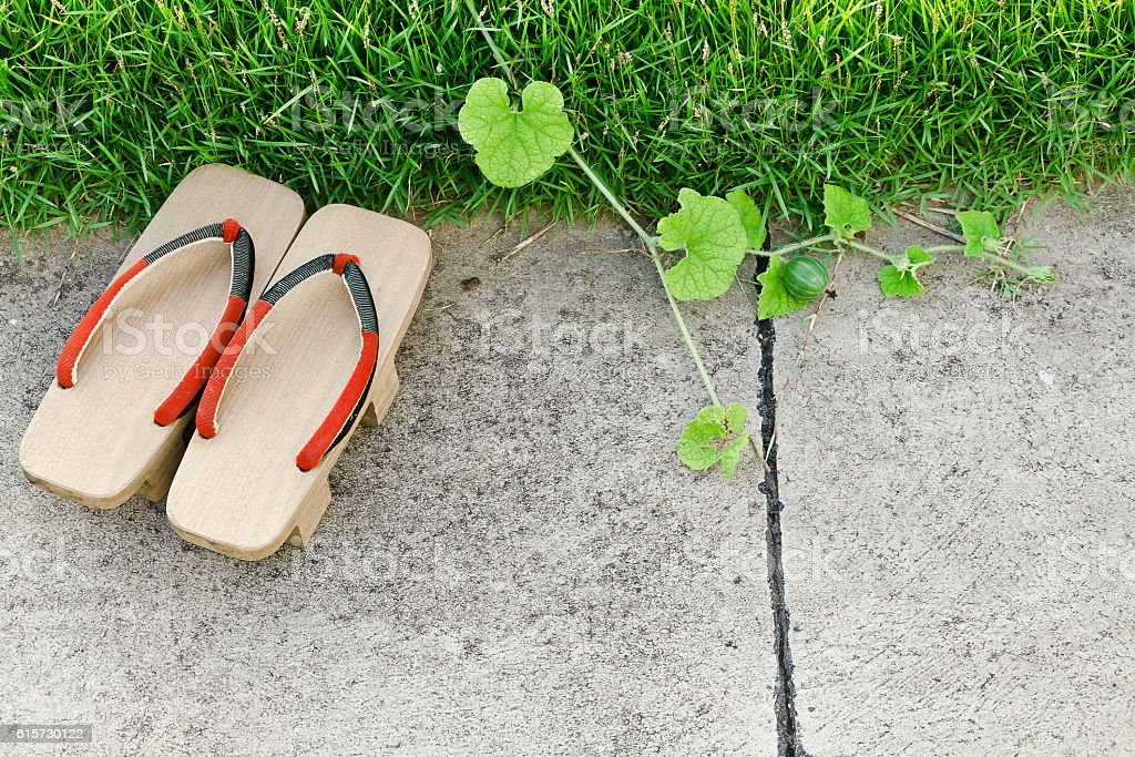 Traditional Japanese 'Geta' slippers.Pair of old Japanese Sandals stock photo