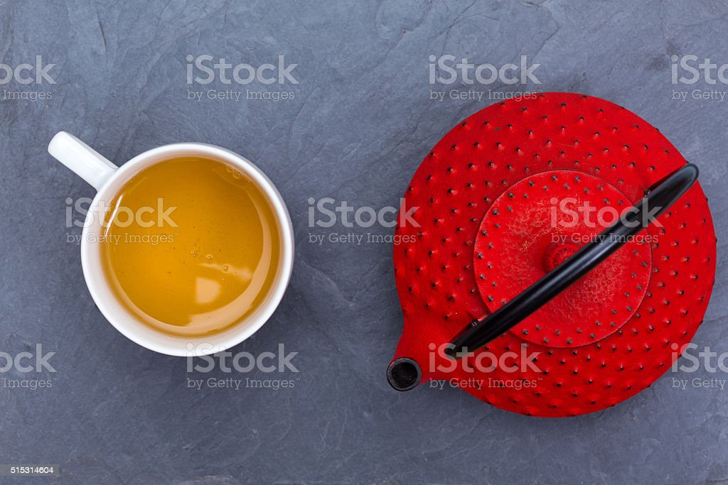 Traditional Japanese red teapot and a cup of tea stock photo
