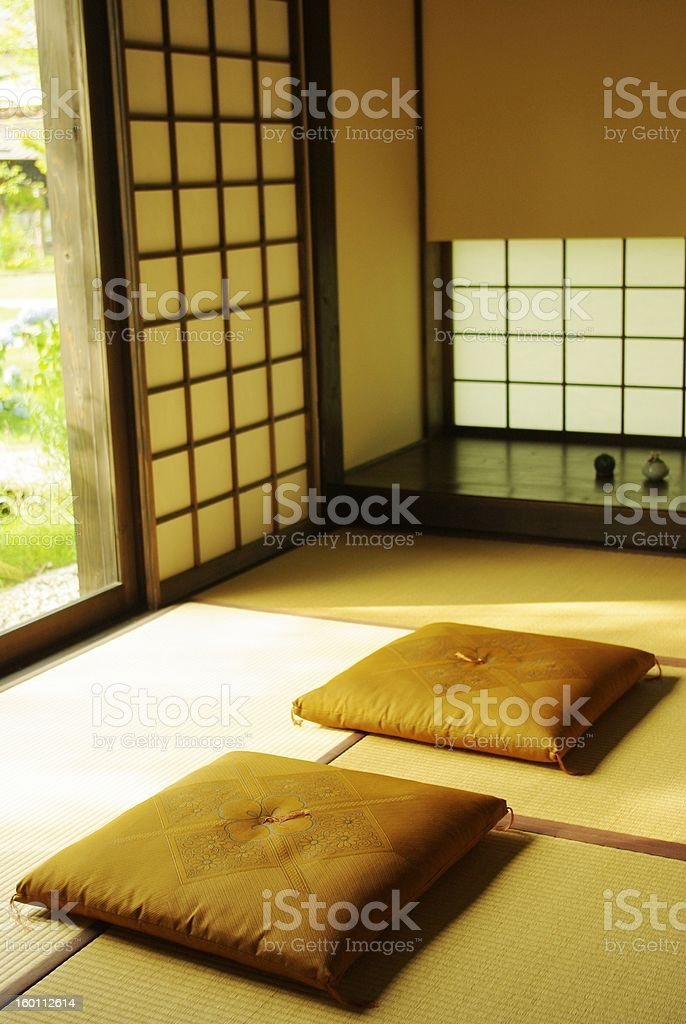 A traditional Japanese room with 2 cushions on the floor stock photo