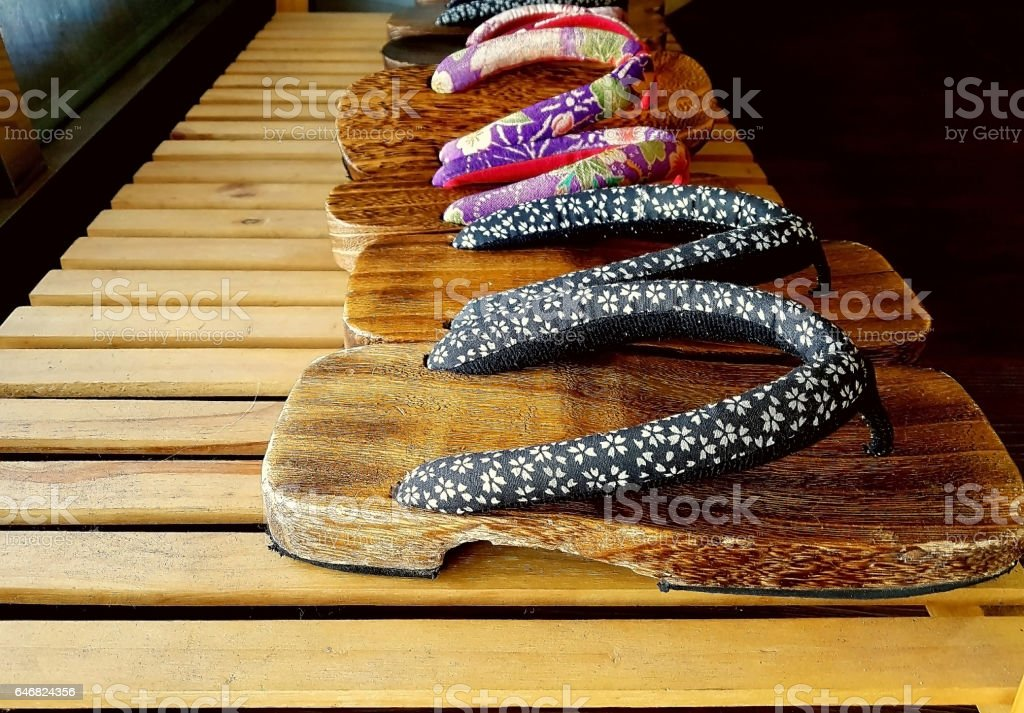 Traditional Japanese shoes placed on a wooden scaffold stock photo