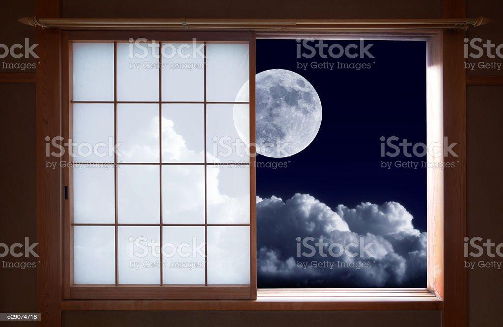 Traditional Japanese sliding window and romantic night sky stock photo