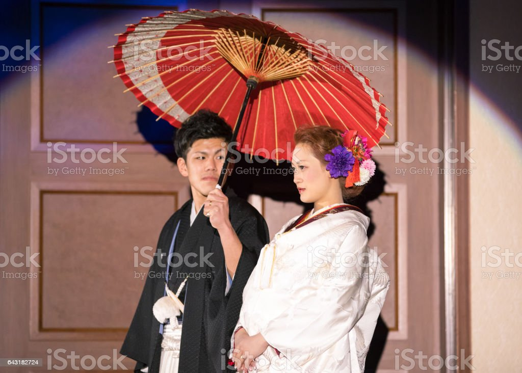 Traditional Japanese style of bride and groom entering party room stock photo