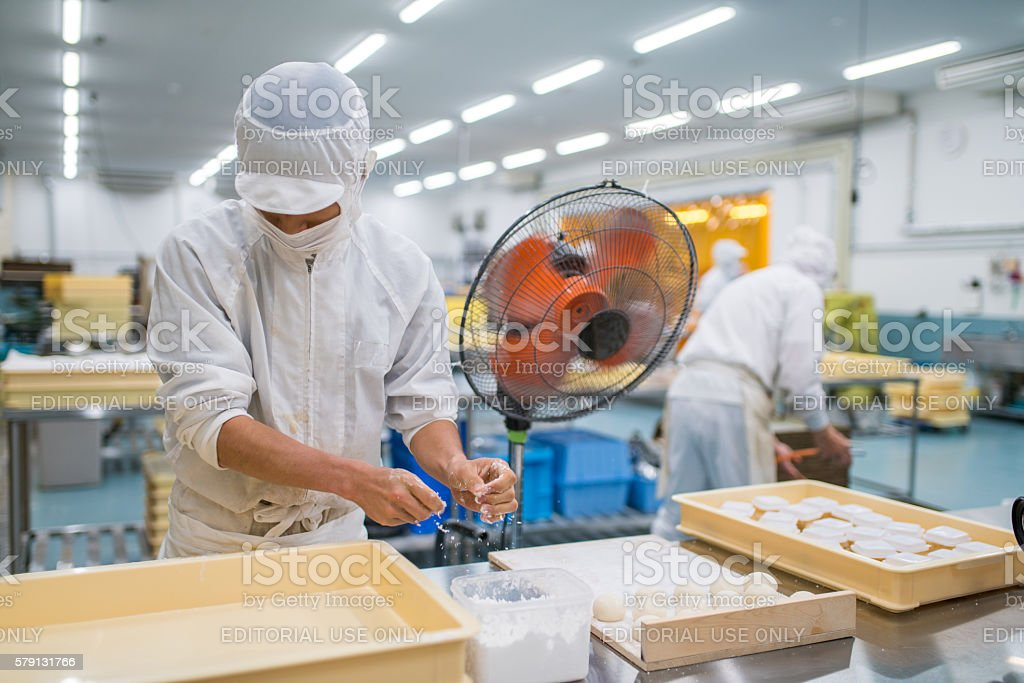 Traditional Japanese sweet factory worker stock photo