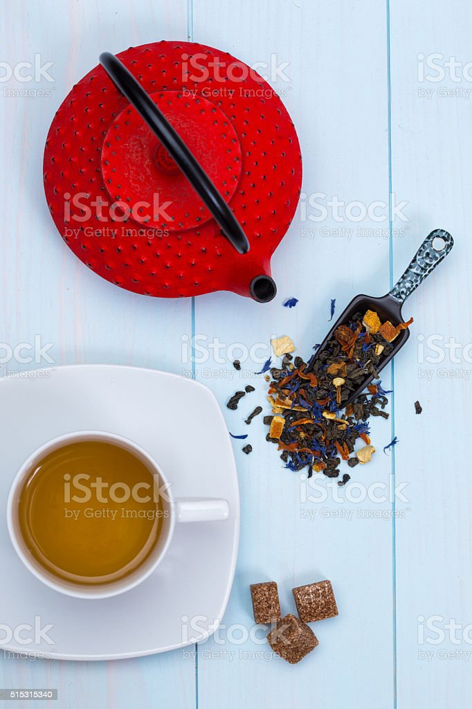 Traditional Japanese teapot, tea, leaves and sugar stock photo