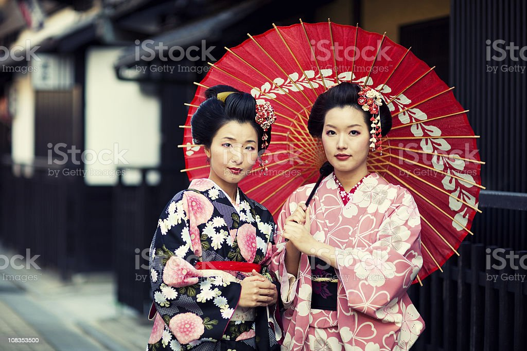 Traditional Japanese Women Dressed in Kimono in Kyoto, Japan stock photo