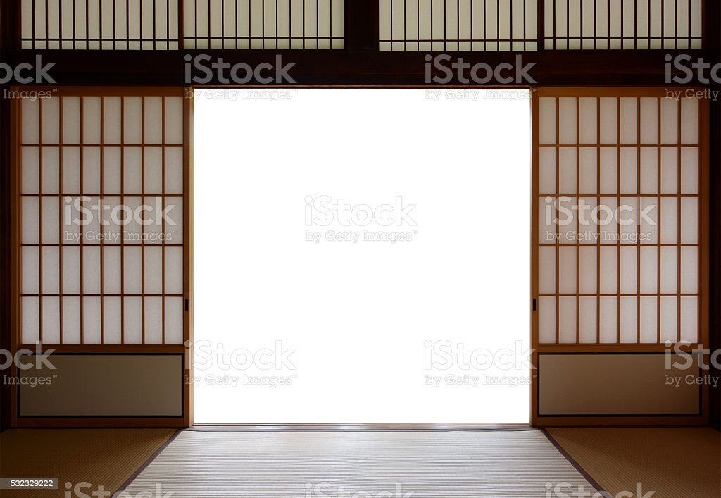 Traditional Japanese wood and rice paper doors and tatami flooring stock photo