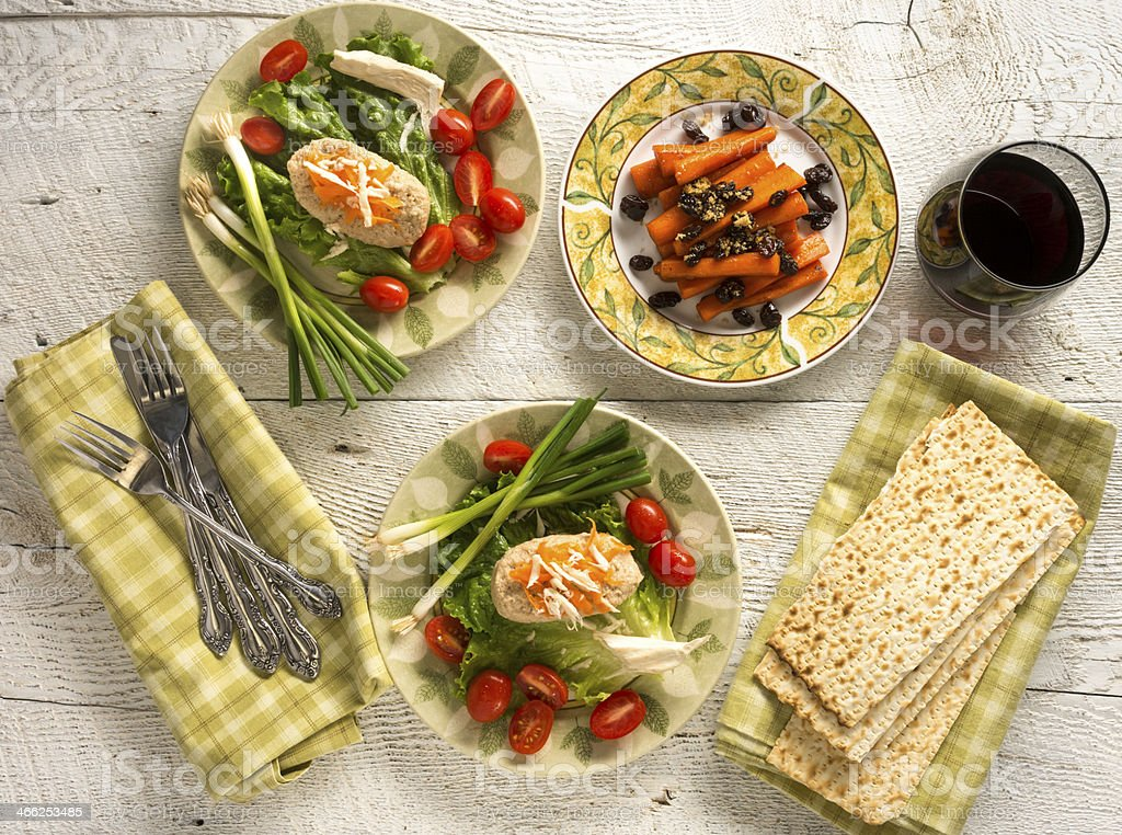 Traditional Jewish Passover dishes of Gefilte Fish and Tsimmes stock photo