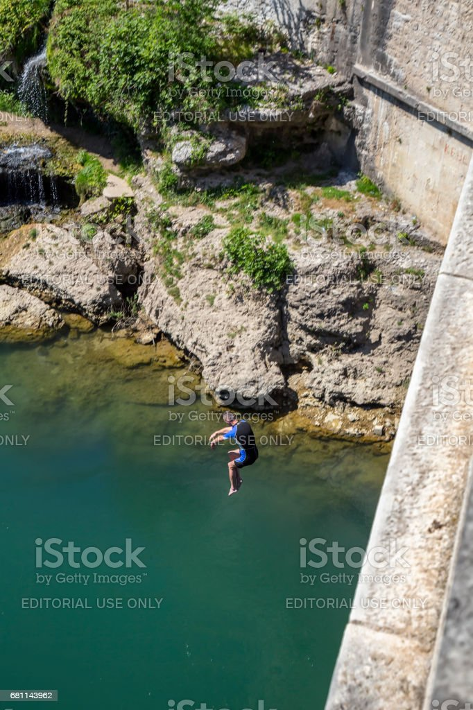 Traditional jumping from the Stari Most bridge stock photo