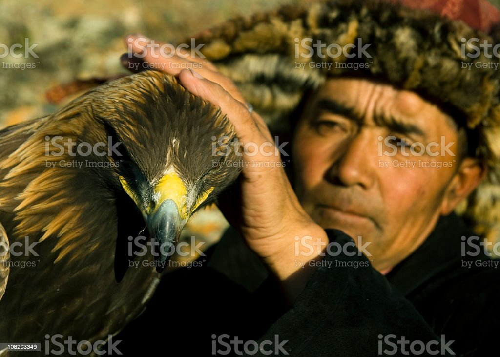 Traditional Kazakh Man with Eagle for Falconry stock photo
