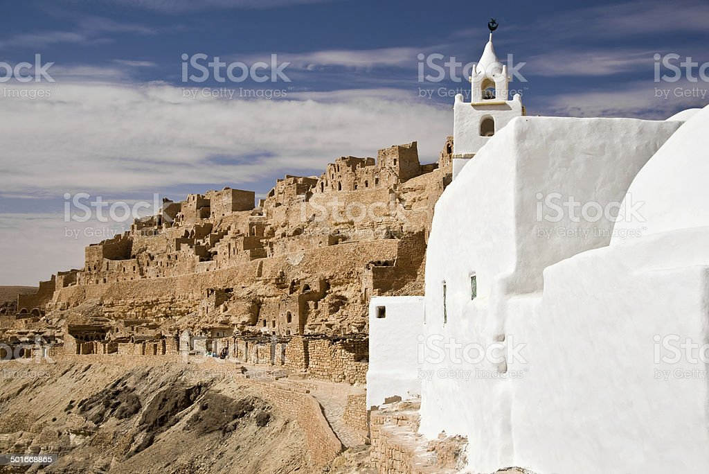 Traditional ksour village of Chenini with the mosque, South Tunisia stock photo