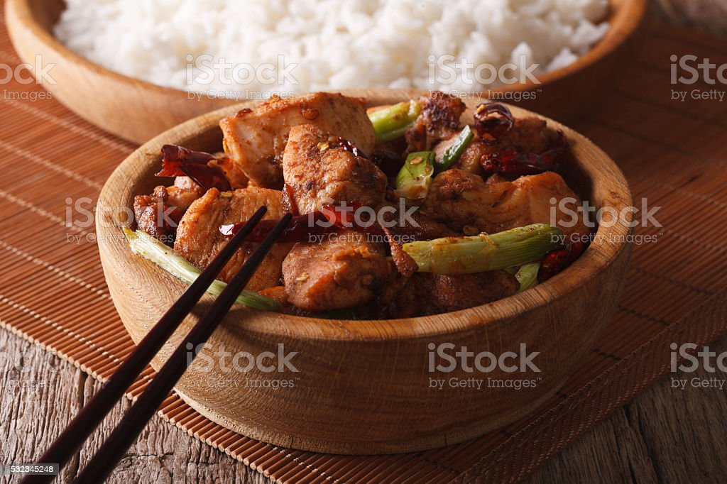 traditional kung pao chicken in a bowl close-up. horizontal stock photo