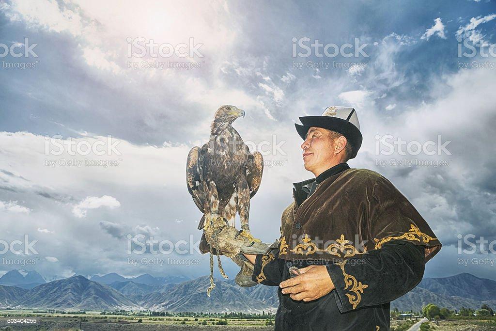 Traditional Kyrgyz Hunter Holding Eagle stock photo