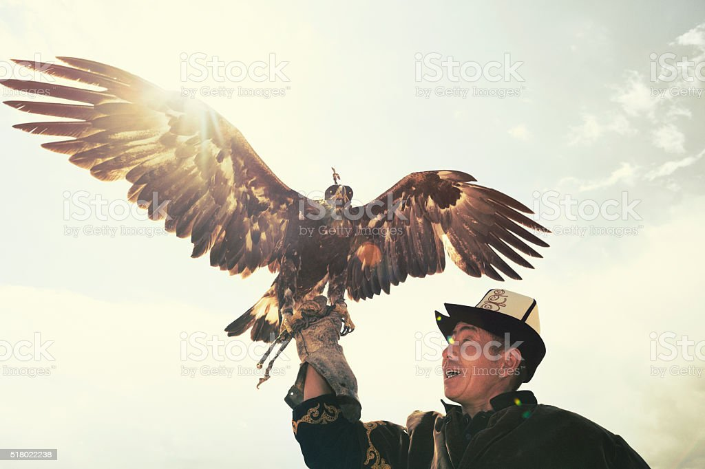 Traditional Kyrgyz Hunter Holding Eagle stock photo