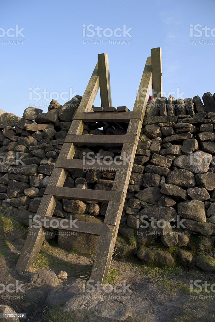 Traditional Ladder Stile over a drystone wall stock photo