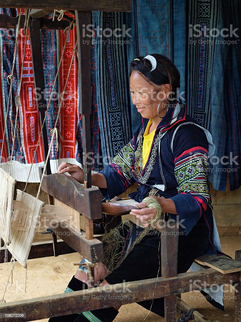 Traditional Lady Operating Weaving Loom stock photo