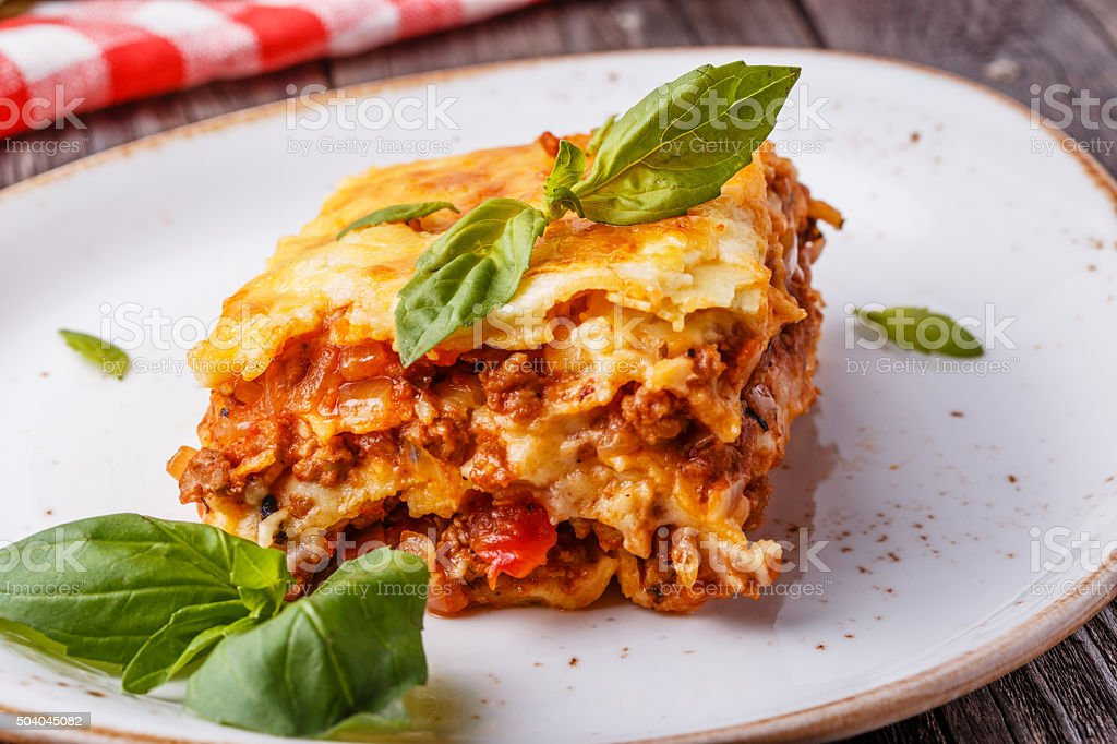Traditional lasagna made with minced beef bolognese sauce stock photo