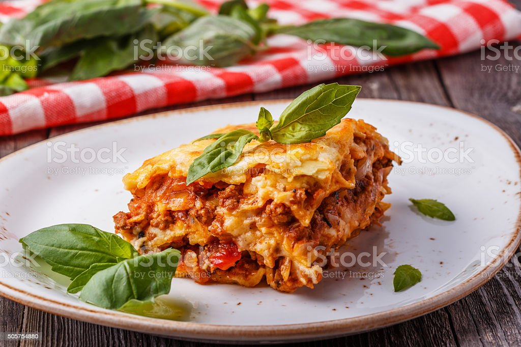 Traditional lasagna made with minced beef bolognese sauce. stock photo