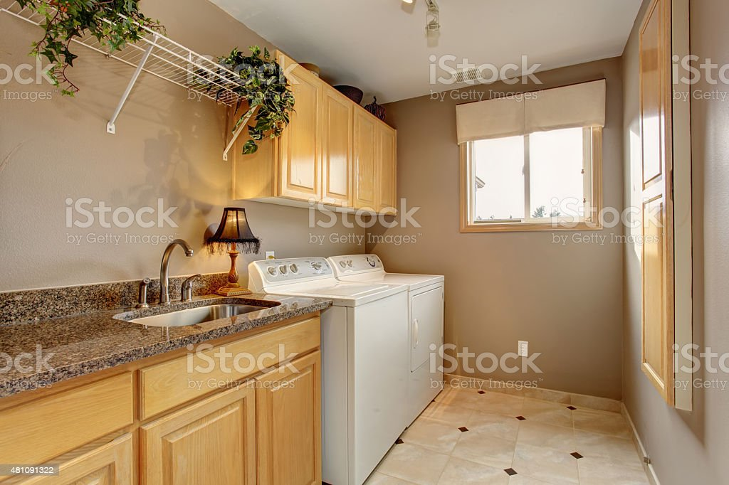 Traditional laundry room with nice counters and washer dryer com stock photo