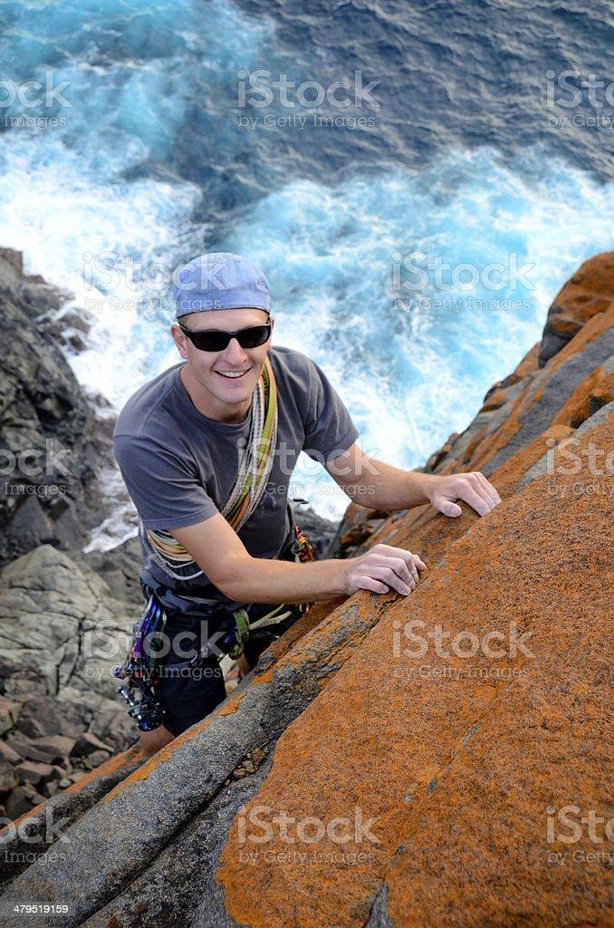 Traditional lead climbing stock photo