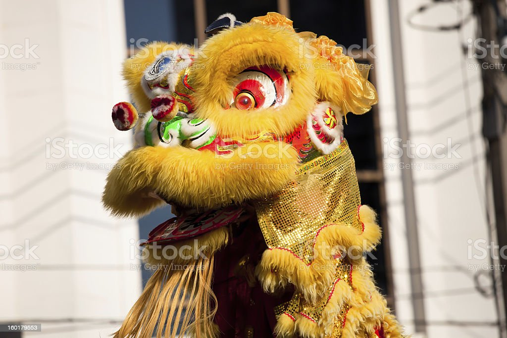 A traditional lion dance in yellow during Chinese New Year stock photo