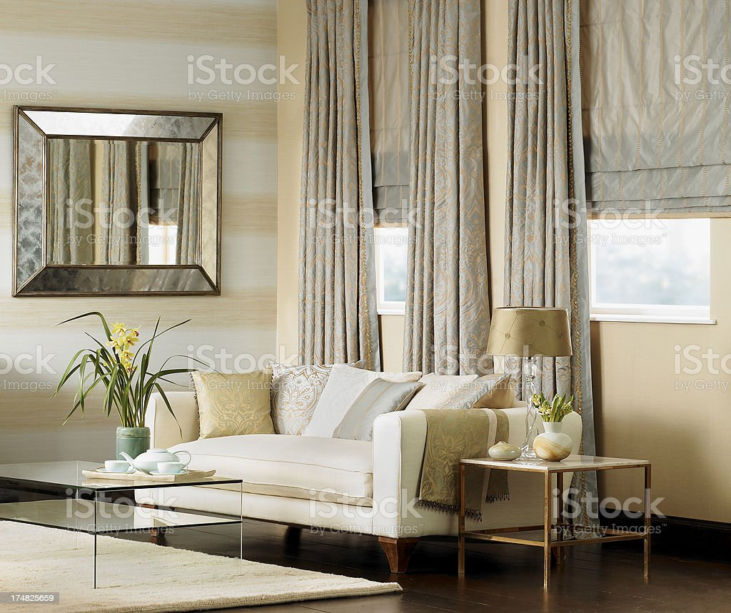 Traditional living room interior with cream sofa stock photo