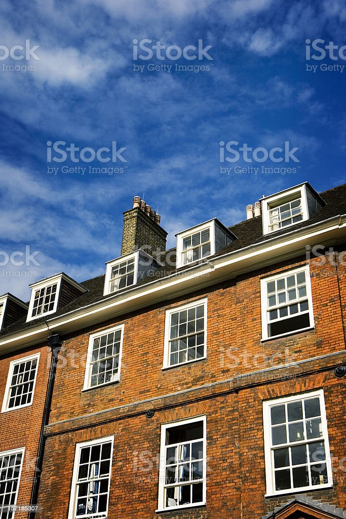 Traditional London red brick Georgian period building with blue skies royalty-free stock photo