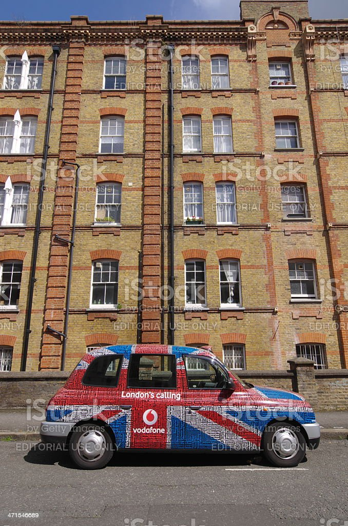 Traditional London Taxi Covered With Vodafone Advertising stock photo