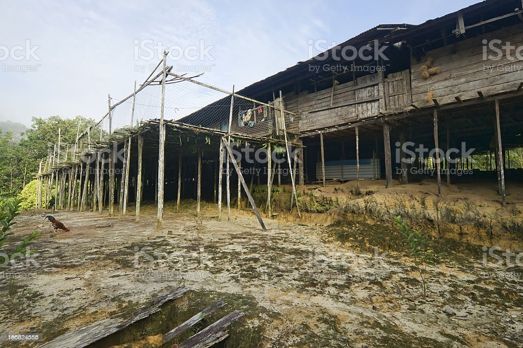 Traditional longhouse in Borneo, Malaysia stock photo