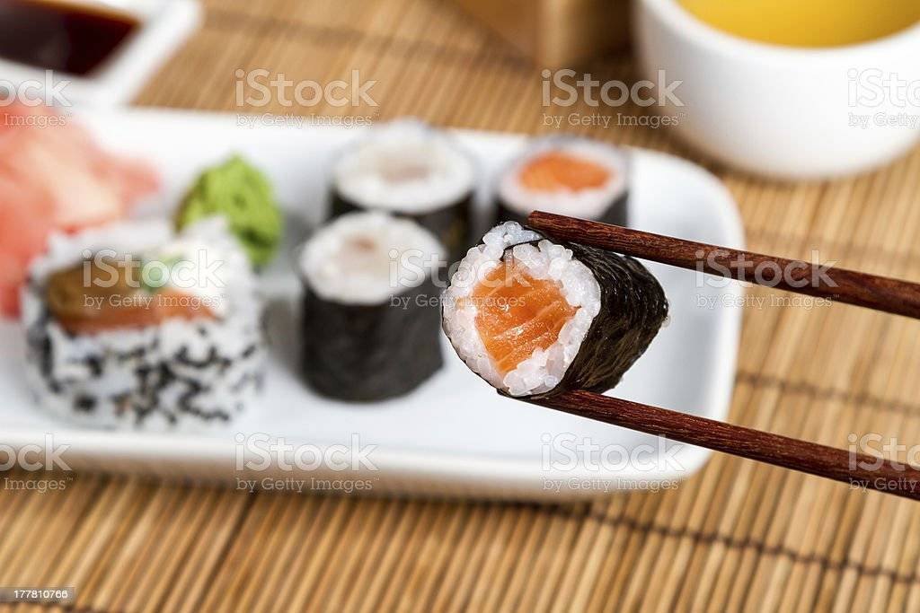 Traditional Maki and Uramaki Sushi on the white plate royalty-free stock photo