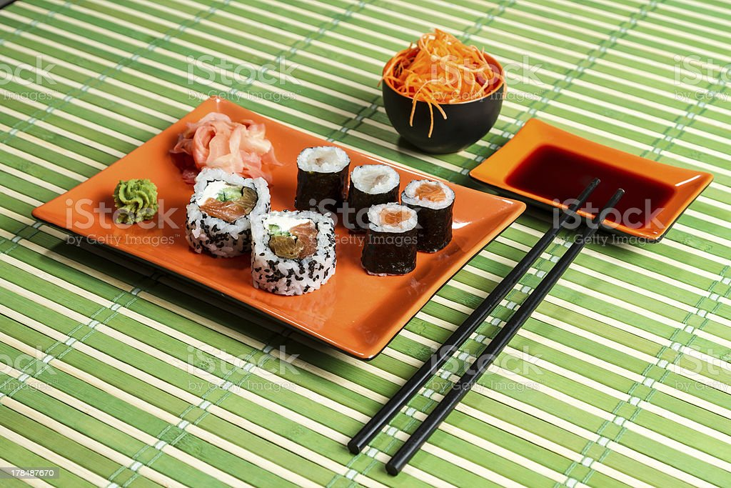 Traditional Maki Sushi on the orange plate royalty-free stock photo