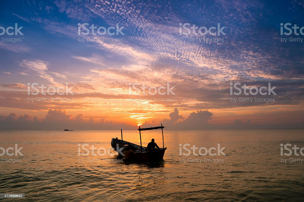 Traditional Malaysian fisherman at dusk stock photo