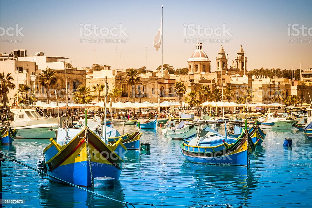 Traditional maltesian Fisherboats (Luzzi) in Marsaxlokk stock photo