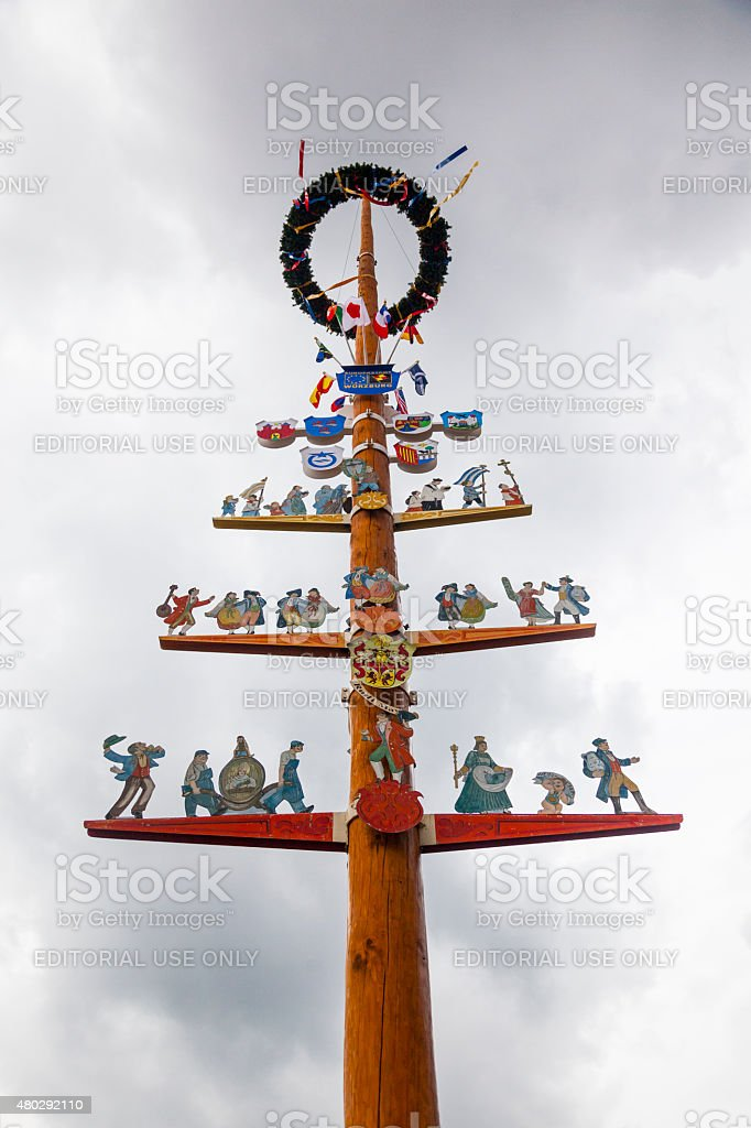 Traditional Maypole over a grey sky stock photo