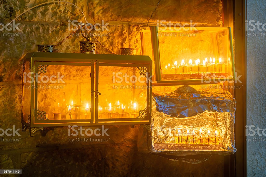 Traditional Menorah (Hanukkah Lamp) with olive oil candles, Jeru stock photo